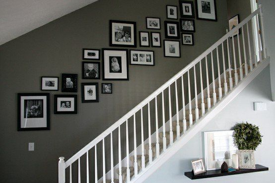 I%u2019m trying to decide how to arrange family photos along our staircase%u2026a universal tip I%u2019ve read is to make sure the center line of frames runs parallel to the incline created by the stairs.