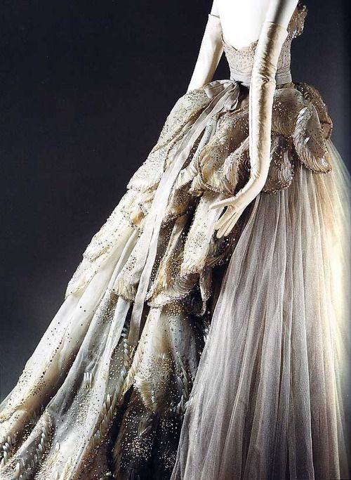 """Venus"" dress by Christian Dior, 1949 // Gray silk net embroidered with feather-shaped opalescent sequins, rhinestones, simulated pearls, and paillettes."