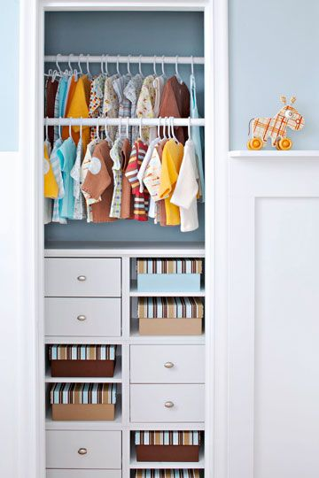 Ditch the closet door! Sliding in modular storage cubes, painting the closet wall, and hanging cuter-than-cute baby clothes makes this closet too cool to hide behind a closed door. Color-coordinated photo boxes keep open shelving shipshape. If you can't keep your kiddo's closet this neat, use a tension rod and a fabric curtain to block the view.
