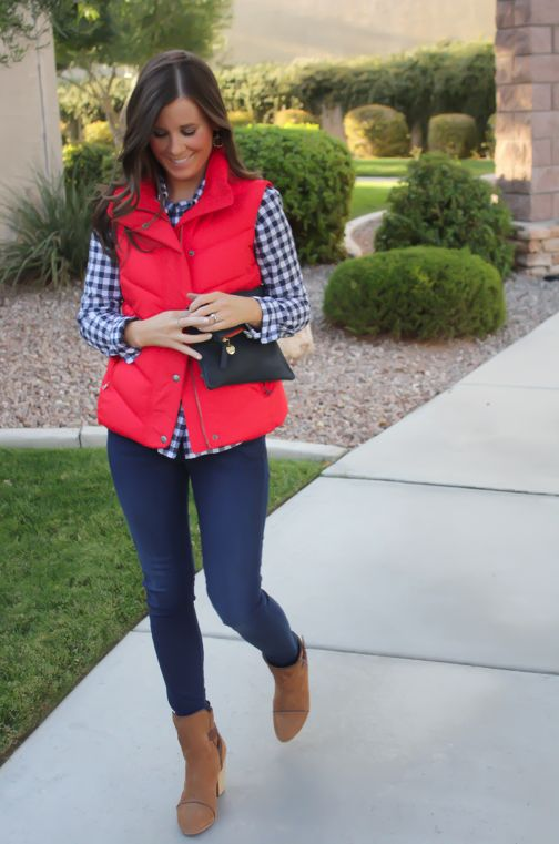 Checkered shirt, red puffer vest, skinny jeans, brown booties