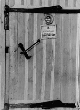A door to a gas chamber in Auschwitz. The note reads: Harmful gas! Entering endangers your life. (February 1945)