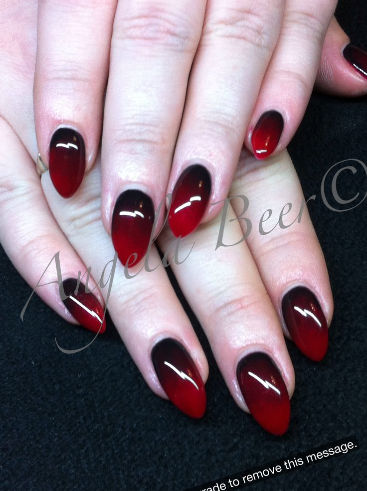 I'm actually pretty close to being able to do this to my nails. They're pointed already, and I'm working on growing them out. I'm not at all sure how to do the black-to-blood-red gradient, though.