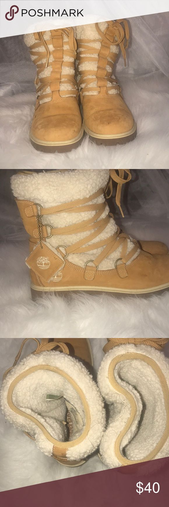 Women's Fur Timberland Boots Women's wheat Timberlands with fur to jazz up style. Has a few scuffs on toes as shown. Timberland Shoes Winter & Rain Boots