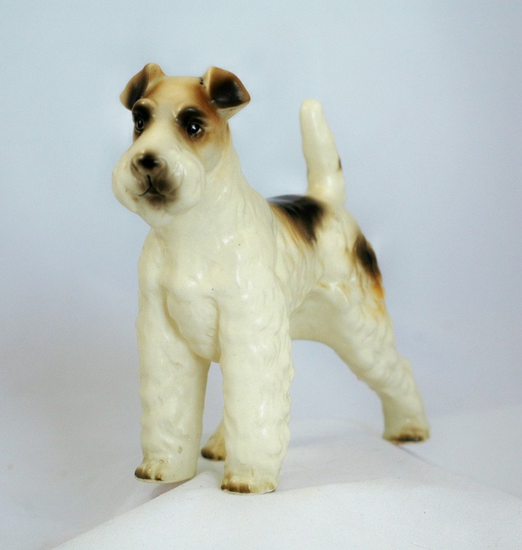 Vintage Porcelain Wire Hair Terrier, Japan One of these sat on our bookshelves for years when I was growing up. We had a wore-haired terrier named Taffy