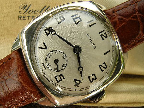 Vintage Rolex Tonneau Watch\;  In a very unusual two piece case and with an engine turned starburst dial, this is a charming example of Rolex production from the inter-war period.