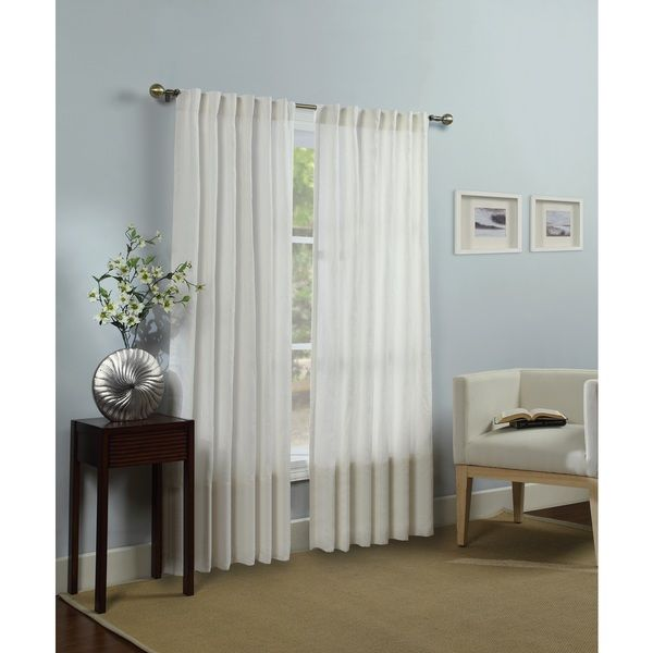 Frame your windows in simple luxury with this natural curtain panel. This panel gives your home a casual and clean feeling while complementing your existing decor. With a rod pocket header, this curta