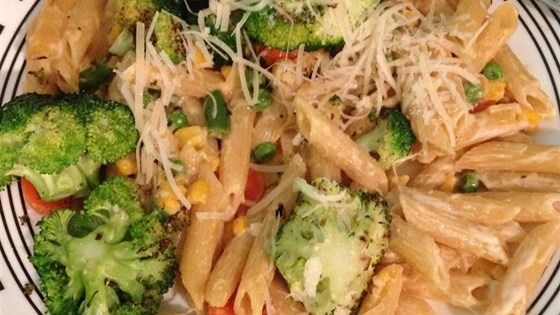 Sauteed broccoli, carrots, and peas serve as the perfect summertime toppings for penne pasta. See the entire recipe from @allrecipes