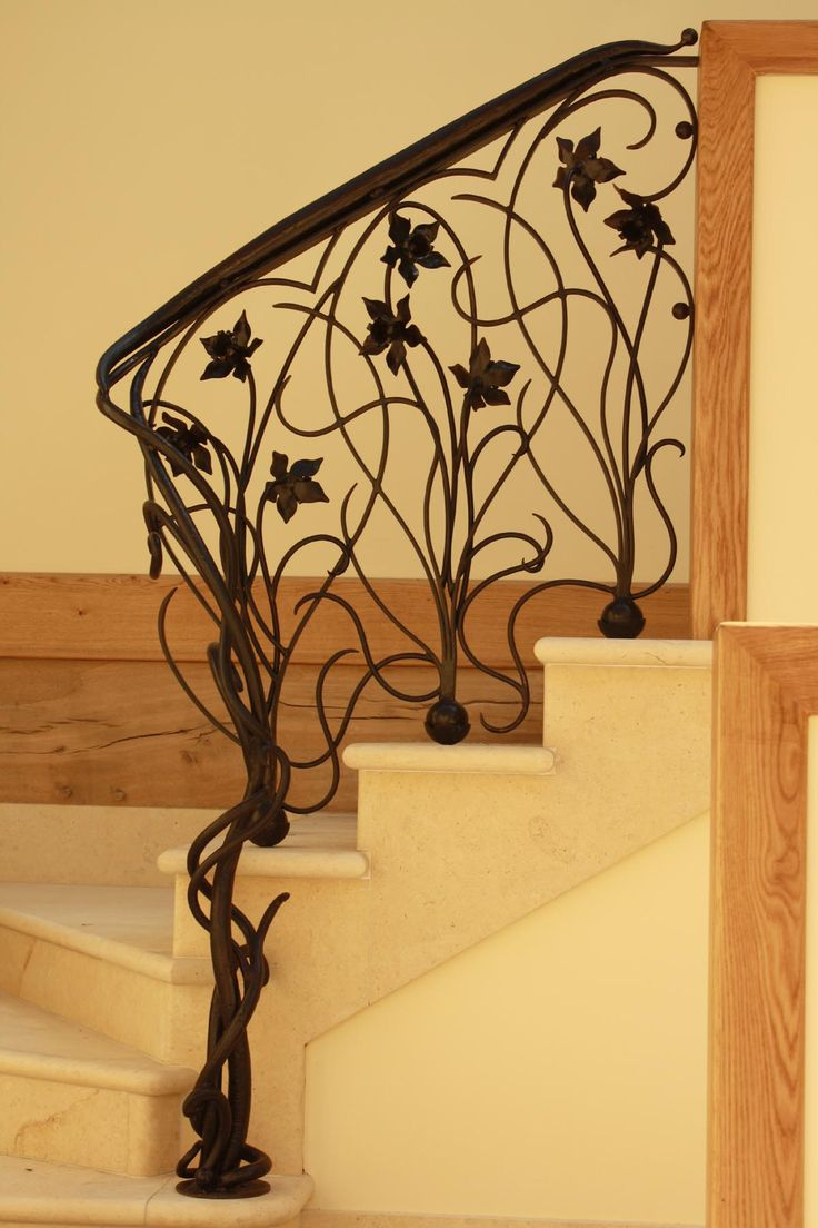 Art Nouveau Wrought Iron Railing. Love the design, though after yesterday's dining set shopping excursion with me electrocuting myself on every even part-metal chair I touched, I am so over metal. Somebody does this in wood, though, I'm all in.