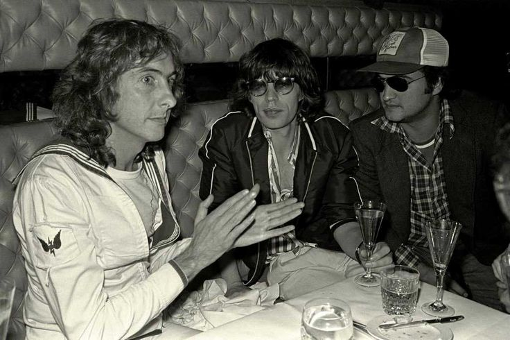Pictures of Rolling Stones members with other famous people eric idle and john belushi with guess who