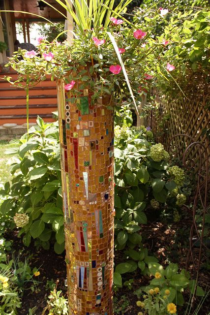 Clay drain pipe turned mosaic flower pot by Spudrick, via Flickr