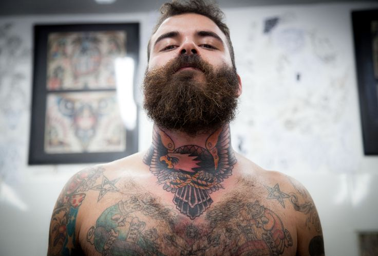 bearded man with traditional eagle neck tattoo