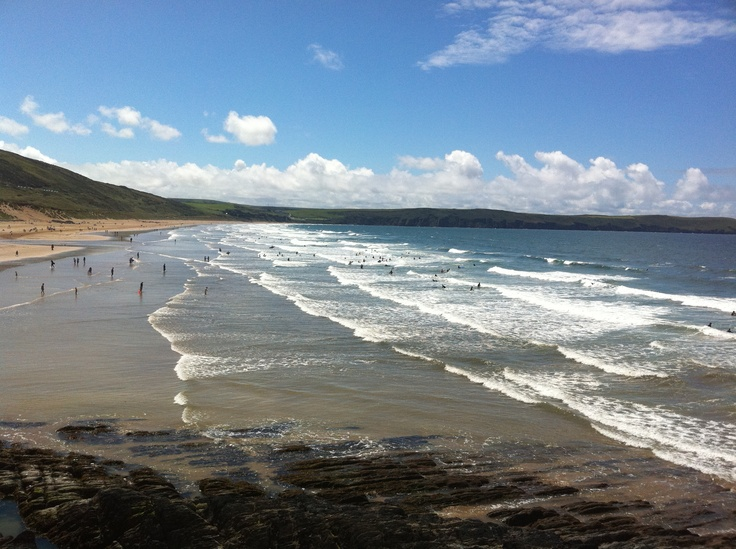 Woolacombe Beach a magnet for surfers , and sun bathers  on a sunny day .