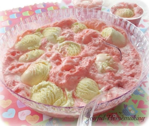 Easy but yummy and popular fruit punch with icecream or sherbert, great for any occasion! http://joyfulhomemaking.com/2014/01/holiday-punch.html #punch