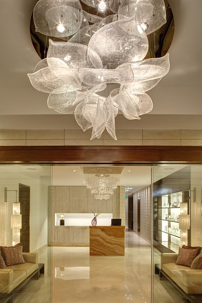 Park Hyatt by Lasvit  May be we can do this type of glass chandelier, several of them in composition should look amazing for the opening space