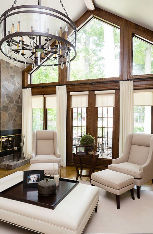 Wonderful high ceilings and window treatments in this for Neutral front room ideas