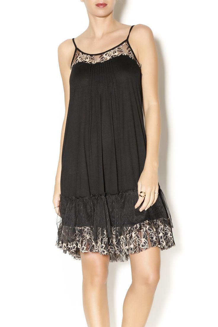 Knit slip dress with bodice detailing and lace layered trim at hem. Worn under a comfy sweater for a casual look, or dress up with a trendy jacket for a night out. Black Slip Dress by Ryu. Clothing - Dresses Houston, Texas