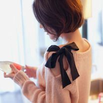 Bow shoulder sweater.