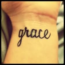 I have this on my back but I was SO close to getting this on my wrist. Still love it.