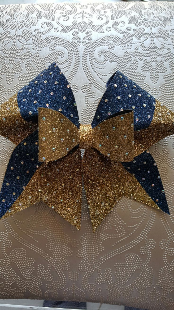 Gold/Navy Rhinestone Cheer Bow by GlamourBowsByAnna on Etsy https://www.etsy.com/listing/271638244/goldnavy-rhinestone-cheer-bow