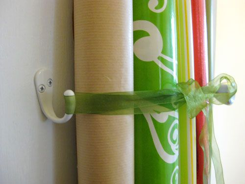 Gift wrap storage inside closet door using Target CD storage bins, hooks and ribbon