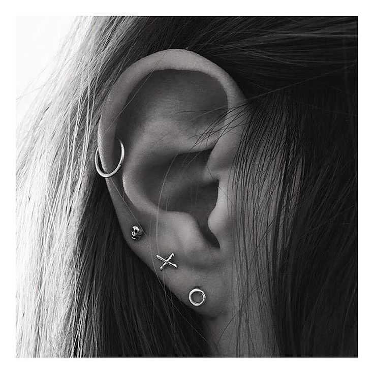 Delicate ear party. Featuring @bingbangnyc's 'XO Studs' & 'Tiny Skull Studs'.