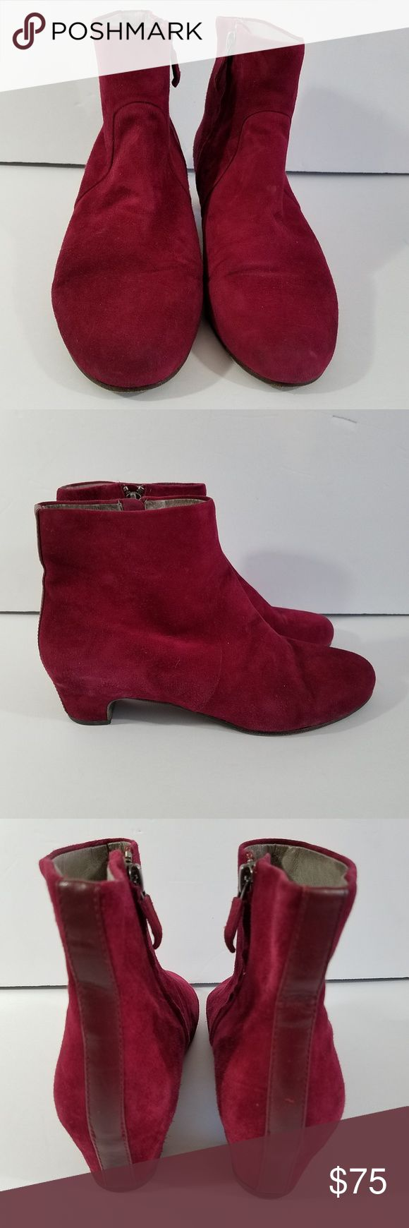 "Eileen Fisher Ankle Boots 6 Suede Eileen Fisher Ankle side Zip boot.  A size 6.  They are a dark Red with a pink tone.  For reference I took a picture next to a Ritz cracker box.  The inside is leather and has a few marks.  Please see the pictures.   They measure 9.25"" toe to heel on the outside bottom.  Small heel of about 1"".  Side zips in good condition.  Please see the pictures for the condition of the shoe.  Mostly suede with a leather strip up the back. Eileen Fisher Shoes Ankle Boots…"