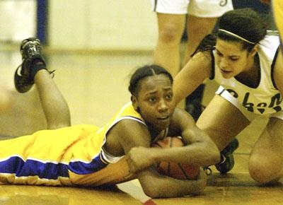 Troy's Chaniece Brown and Shenendehowa's Alyssia Marsal battle for the ballon the floor during first quarter of high school girls sectional basketball action Friday, February 23, 2012 at Albany High School. (J.S. Carras / The Record)