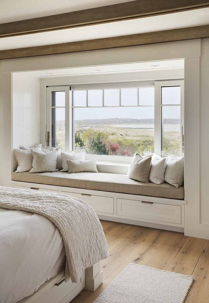 Now this is a window seat with a view. A great setting for any proud dad to gaze out at his kids at play in this gorgeous beach house in Martha's Vineyard.