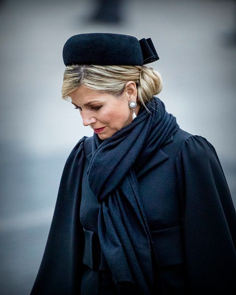 Queen Maxima looks elegant in black, she teamed her outfit with pearl teardrop earrings, a matching brooch and a black hat as she attends annual Remembrance Day commemorations in The Netherlands