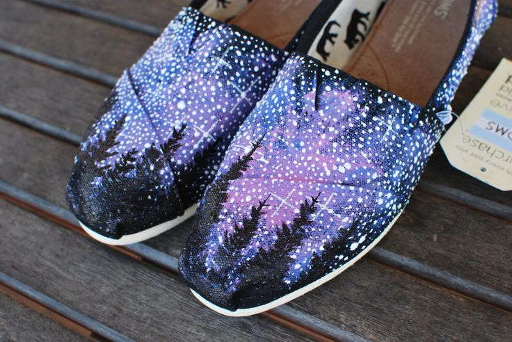 This pair of custom hand painted Galaxy TOMS feature the silhouette of pine trees going across the tops of the shoes to give the feel of being in Alaska. Check my Galaxy TOMS listing for the same desi