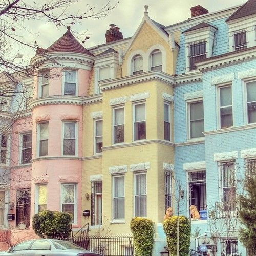 The pink, yellow and blue ballerinas live next to each other in matching houses.