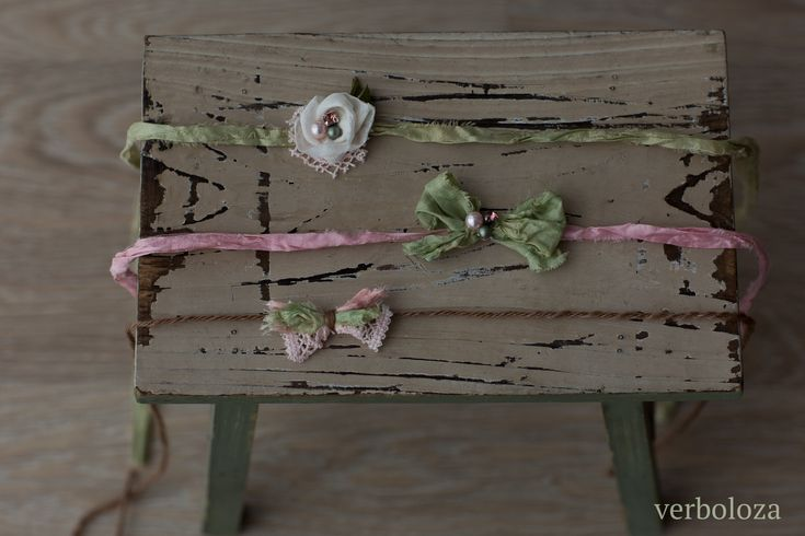 Cute newborn headbands or photo props, handmade in Latvia incorporating Perran Yarns handdyed recycled sari silk ribbons