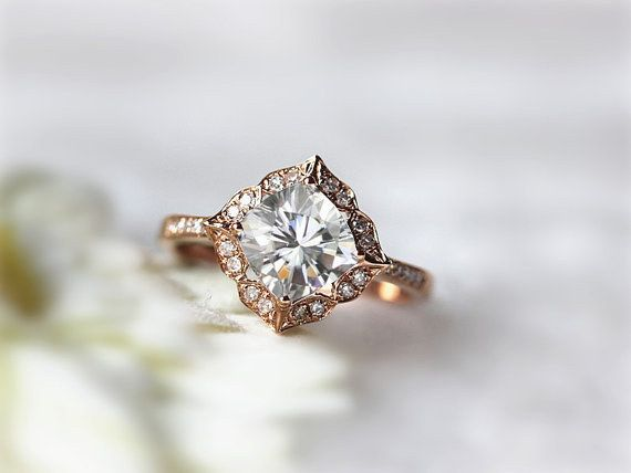 This floral-inspired moissanite ring: | 43 Rose Gold Engagement Rings That Are Beyond Beautiful