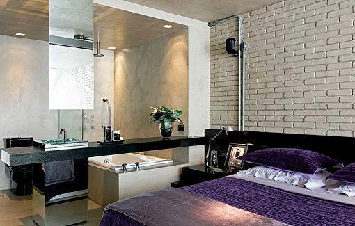 Loft de estilo industrial: dormitorio con baño integrado
