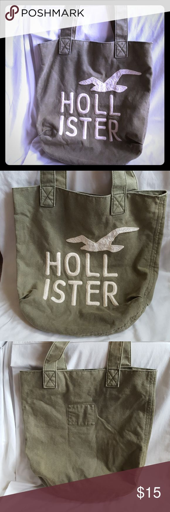 "Hollister Tote Bag in Army Green Classic Hollister tote bag in army green, khaki,  avocado or olive green. Bag is 16"" tall x 15"" wide. Handles add 8"" to height.  Very good used condition. Smoke free and pet free home. Hollister Bags Totes"