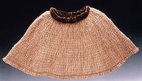 Lisa Telford : uses the materials and techniques of traditional Haida weaving. Canoe Cape, 2001; red cedar bark, cotton cordage, spun yellow cedar cordage, sea otter fur trim; pounded and softened red cedar bark,cooked thigh spun yellow cedar cordage, woven; Photo: Jerry McCollum.