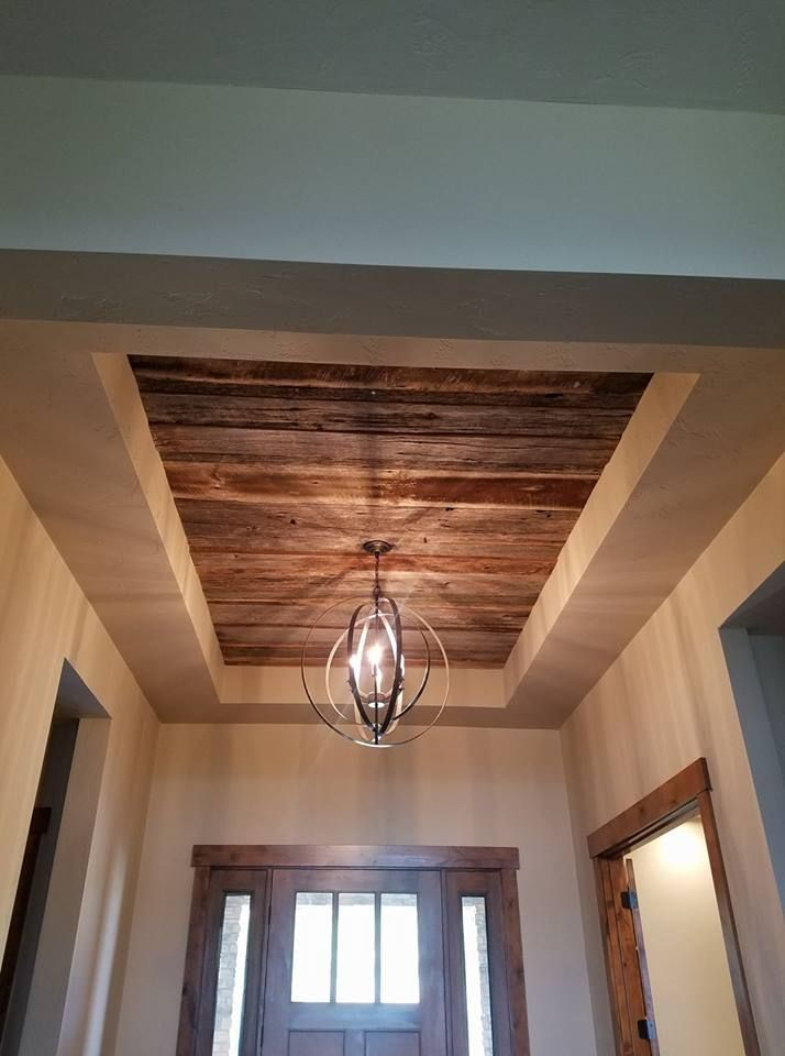 Reclaimed barnwood used in recessed space in ceiling. Pinned by Heather Hudson Realtor® www.heatherhudson.com