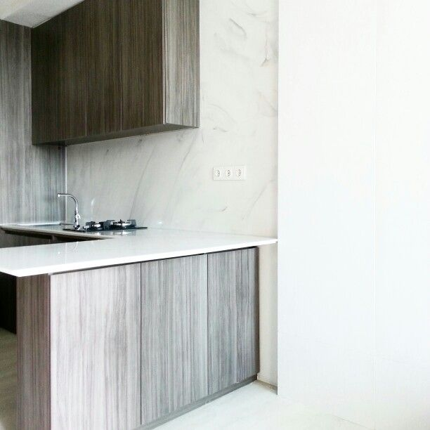 Kitchen counter design with white marble top + wood cabinet - 1 bedroom apartment.