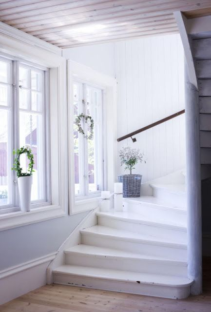curving white stairs swept with light -