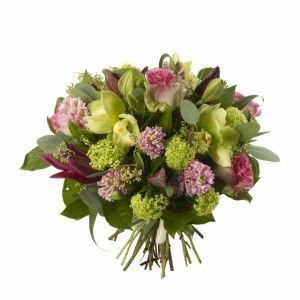 Green or White Cymbidium, Malibu Roses, Pink Hyacinths and Gelder Rose.