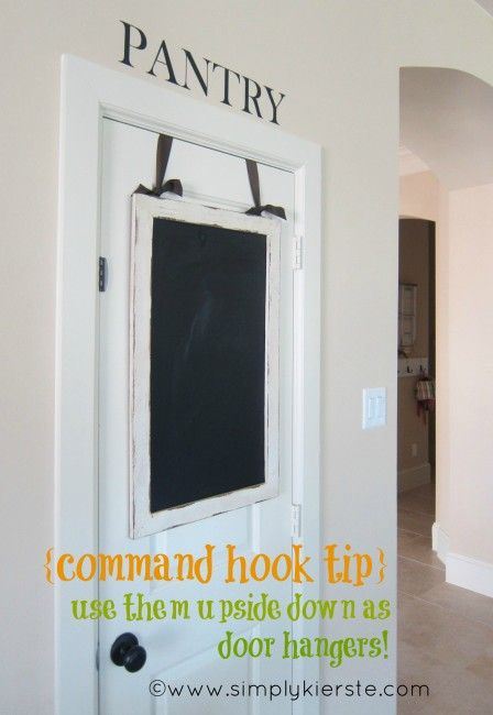 {reason #558 to ♥ command hooks} by SimplyKierste.com -- use them upside down as door hangers. Genius! And a lot less bulky than a regular over-the-door hanger!
