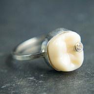 Diamond tooth. A cute way to display baby teeth: as halloween jewelry!