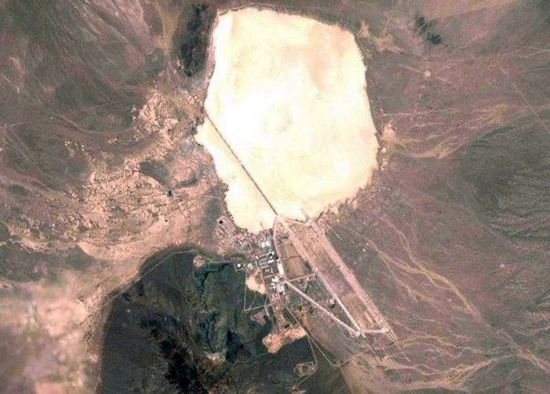 Declassified Military & CIA Secrets -Almost no other site has garnered as much attention from conspiracy theorists and UFO-enthusiasts as Area 51, a remote desert tract near Groom Lake in Nevada, roughly 83 miles (134 kilometers) northwest of Las Vegas. The intense secrecy surrounding the base sparked peoples' imaginations, and Area 51 was commonly linked to paranormal activities, including pervasive theories that suggested Area 51 hid aliens and UFOs.