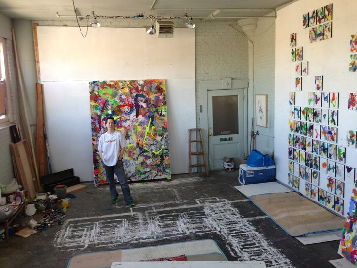 Gallery artist dory goode in her studio space showcasing many of her stimulating colorful