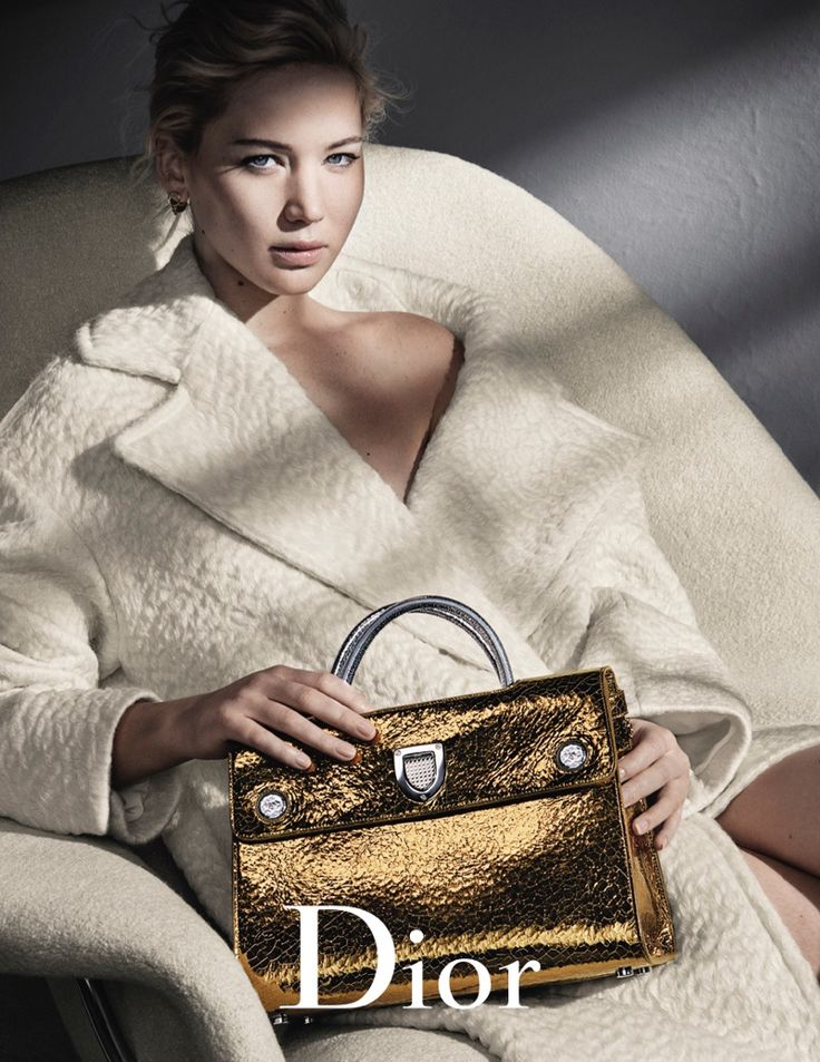 Jennifer Lawrence looks cozy in Dior cream coat for fall 2016 advertising…