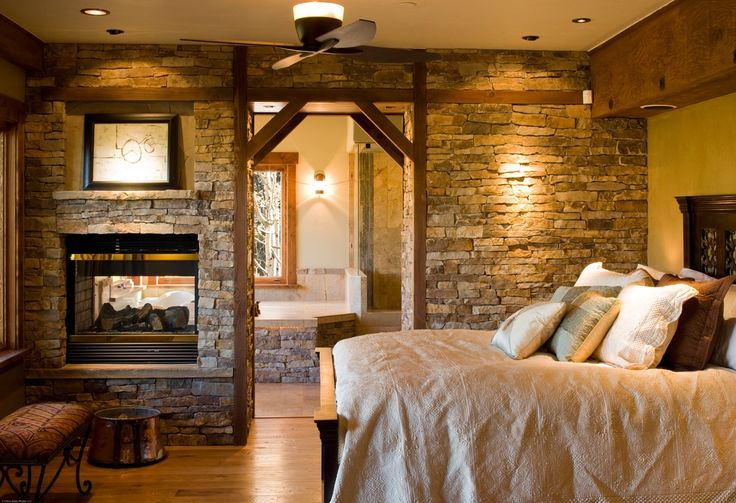 Rustic Master Bedroom With Standard Height Exposed Beam Insert Fireplace Can Lights Wall
