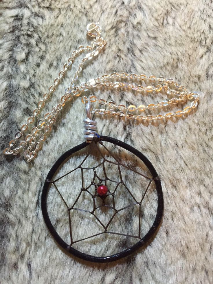 Hand wrapped, woven and painted dreamcatcher pendant with red glass pearl and 18' nickel free chain by EarthDiverCreations on Etsy https://www.etsy.com/ca/listing/496802023/hand-wrapped-woven-and-painted