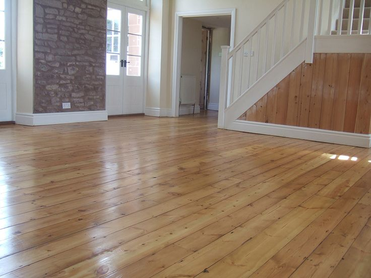 Pine Floorboards In Hallway Sanded And Stained