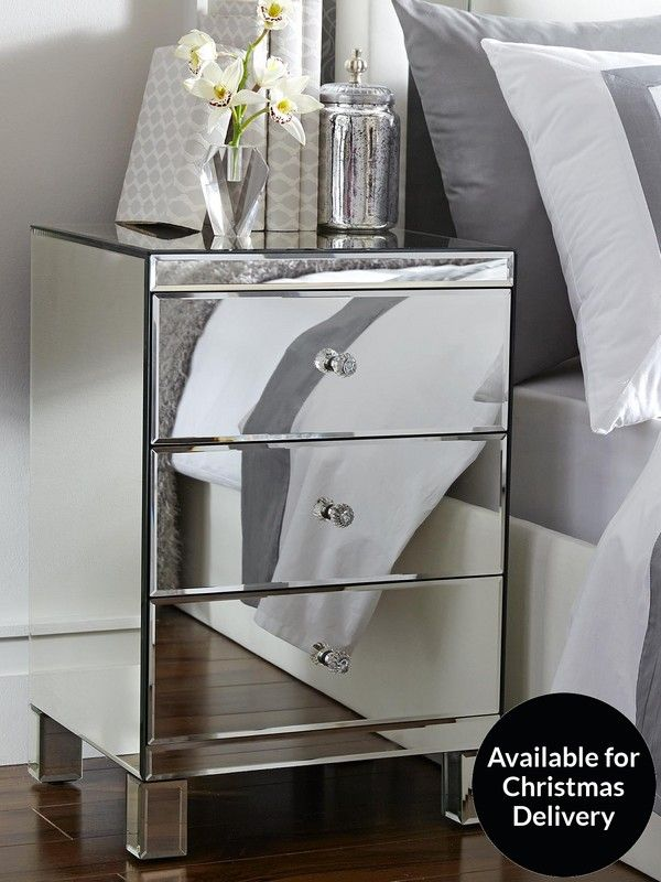 Parisian Mirrored 3-Drawer Ready Assembled Bedside CabinetInspired by the breathtaking designs of traditional French furniture, our Parisian collection will add fresh levels of reflective elegance to your bedroom.This bedside cabinet's mirrored glass finish draws in the light around it and splashes it back out into the room, creating a brighter, deeper space that enhances the style and colours of your decor.For added indulgence, the three drawers are accented with sparkly crystal-effect…