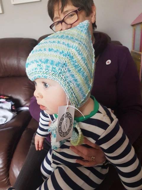 cutie in a pixie hat! www.facebook.com/lochielknits